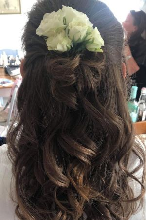 HAIRSTYLES WITH FLOWER ACCESSORIES AT LA SUITE HAIR & BEAUTY SALON IN CORBRIDGE
